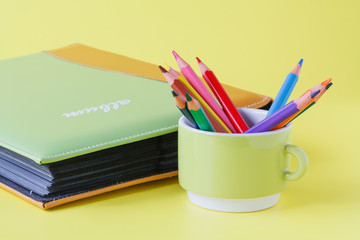 albums for pictures and pen in mug