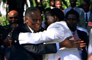 Angolan rivals President Eduardo dos Santos (L) and UNITA leader Jonas Savimbi (R) embrace May 6. Bo..