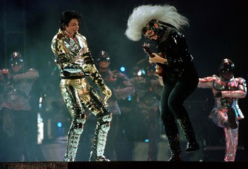 Pop star Michael Jackson (L) performs on stage with a guitarist from his band during his first Sydne..