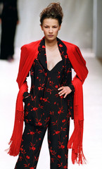 A model for Japanese designer Hanae Mori presents this floral print cocktail pantsuit with matching ..