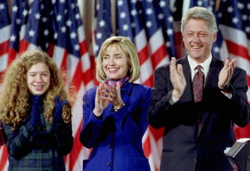 President - elect Bill Clinton with his wife Hillary (c) and his daughter Chelsea (l) reacts after t..