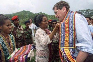 AMERICAN AMBASSADOR TO THE UN IS PRESENTED A SCARF IN EAST TIMOR.