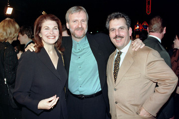 Director James Cameron (C) poses with Sherry Lansing, chairman, Motion Picture Group, Paramount Stud..