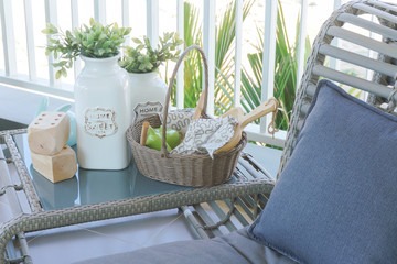 Close up pillow on ratten easychair at the balcony