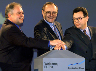 (L-R) Rainer Roubal, president of the Frankfurt trading association, Patrick de Silguy, charge des a..