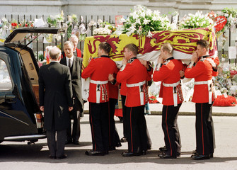 The coffin of Diana, Princess of Wales, is placed into a hearse following a funeral service at Westm..