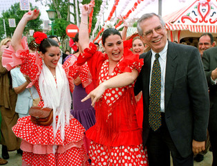 Newly-elected Socialist candidate Jose Borrell smiles next to women dancing Flamenco during a visit ..