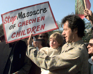 IMRAN KHAN GIVES PLACARD TO HIS SON IN ISLAMABAD.