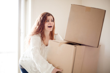Redhead Woman House Moving Dropping Carboard Boxes