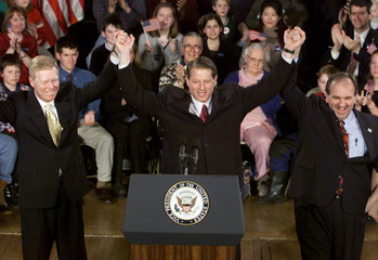 VICE PRESIDENT GORE STANDS BEHIND PODIUM WITH GEPHARDT AND SHAHEEN.