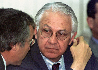 Argentine Foreign Minister Guido di Tella listens to an aide during the opening session of meetings ..