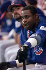 SOSA SITS ON BENCH WITH BAT IN NINTH INNING AGAINST ASTROS.