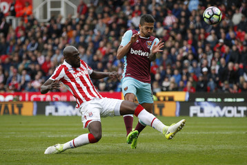 West Ham United's Manuel Lanzini in action with Stoke City's Bruno Martins Indi