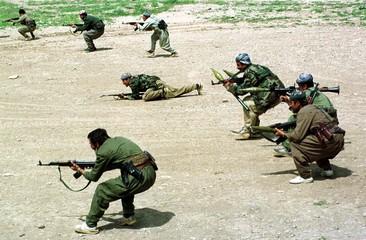 FILE PHOTO APR91 - Kurdish Peshmerga fighters conduct war exercises near the Iraqi town of Dohuk in ..