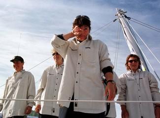 British skipper Tracy Edwards wipes off a tear while crewmates (LtoR) Hannah Sherwood, Miranda Merro..