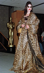 A model wears a Leopard coat costume by Isabel Kristensen and a diamond choker by Harry Winston duri..