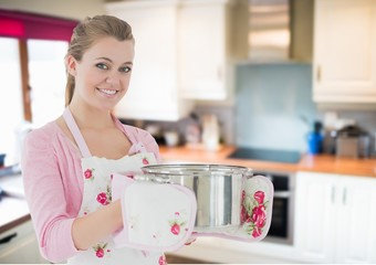 woman cooking with the saucepan in home