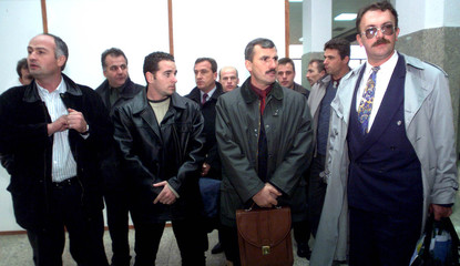 MULTI-ETHNIC DELEGATION STAND AT SLATINA AIRPORT ON THEIR ARRIVAL FROM FRANCE.
