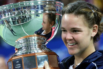 World number one Lindsay Davenport of the United States holds up a trophy [after beating compatriot ..