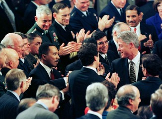 US President Bill Clinton is surrounded by supporters after his State of the Union address to a join..