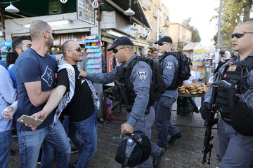 A Palestinian protester clashes with Israeli police during a demonstration in support of Palestinian prisoners held in Israeli jails, outside Jerusalem's Old city