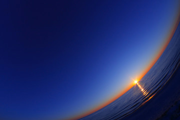 Beautiful sunset on the sea. Fisheye lens