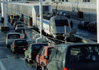 "French registerd cars drive into ""Le Shuttle"" express before passing through the Channel Tunnel on t.."