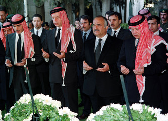 Jordan's King Abdullah (R) joins with his uncle Prince Hassan and his brothers Prince Feisal and Pri..