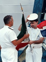 An Italy's sailor arranges his flag and cap before the arrival of General Wesley Clark, Supreme Alli..