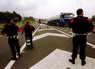 An Ertzaintza (Basque Autonomus Police) members control a main road near the Basque village of Ermua..