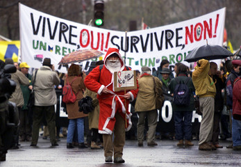 JOBLESS DEMONSTRATORS DRESSED AS SANTA CLAUS DURING MARCH PROTEST.