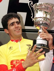 Spanish winner cyclist Miguel Indurain lifts up the trophy at the podium after the XXI L'Hospitalet ..