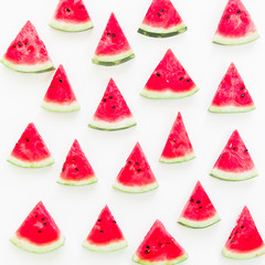 Tasty slices of juicy watermelon on white background. Flat lay. Top view. Summer pattern