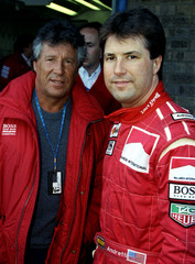 Michael Andretti of team Marlboro McClaren stands with his father, 1978 Formula One world champion, ..
