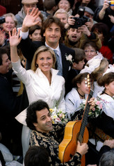French tennis star Henri Leconte and French bullfighter Marie Sara wave to the crowd after their wed..