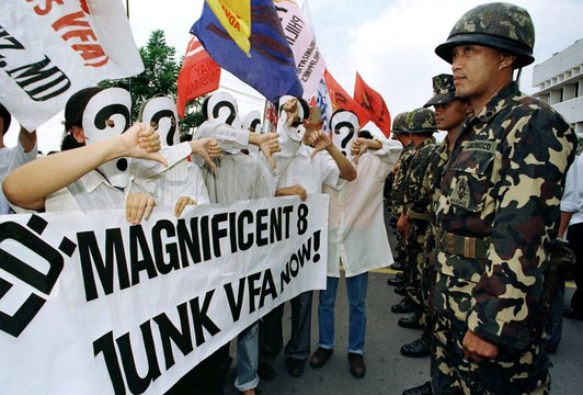 FILIPINO MILITANT STUDENTS WEARING MASKS GIVES A THUMBS-UP DOWN SIGN IN MANILA.