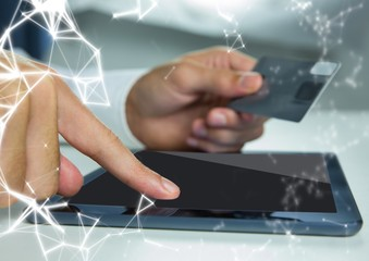 Hands with tablet and credit card and white network overlay