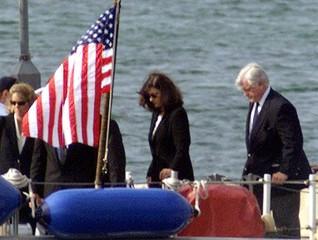 U.S. Senator Edward Kennedy (R) and his wife Vicky (C) board the Coast Guard cutter Sanibel in Woods..