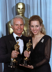 """PRODUCERS RICHARD AND LILI FINI ZANUCK HOLD UP OSCARS AFTER WINNING BEST PICTUREAWARD FOR """"DRIVING MISS ..."""