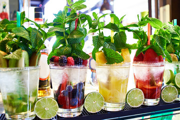 Fruit and berry cocktails with mint on cafe