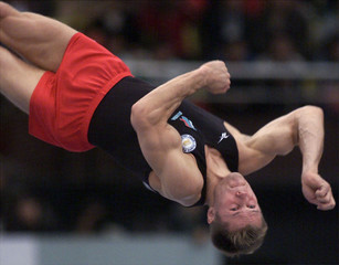 RUSSIA'S ALEXEI NEMOV PERFORMS ON FLOOR EXERCISE TO WIN INDIVIDUAL APPARATUS FINALS IN TIANJIN.
