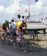 AMERICAN LANCE ARMSTRONG LEADS THE PACK THROUGH THE PASSAGE DU GOIS CAUSEWAY DURING TOUR DE FRANCE STAGE.