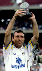 Hristo Stoichkov of the Parma team from Italy holds up the Most Valuable player award after his team..