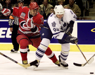 MAPLE LEAFS BEREZIN HOOKED BY HURRICANES KOVALENKO IN NHL ACTION.