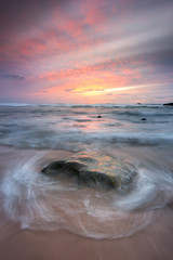 Last tones of a beautiful sunset on isolated beach