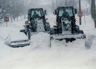 Heavy equipment of the 152nd Engineer Battalion, New York State National Guard navigate snow-covered..