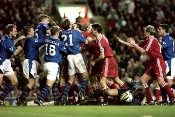 Liverpool and Everton players brawl after an incident involving Everton goalkeeper Neville Southall ..
