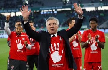 Bayern Munich coach Carlo Ancelotti celebrates after the match after winning the Bundesliga