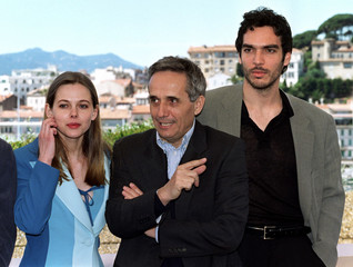 Italian director Marco Bellocchio (C) points as he stands between Slovak Republic actress Barbora Bo..