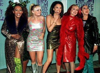 British pop group the Spice Girls (L-R) Mel B, Emma, Victoria, Geri and Mel C pose for a picture upo..